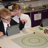 Photograph of two  pupils  making an animation movie using a school iPad and the Stickbot app