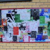 Picture of the second  large colourful mural fix to a wall in the Primary playground