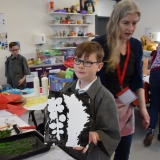 Picture of a pupil holding his finished print art work