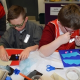 Picture of two pupils doing art work