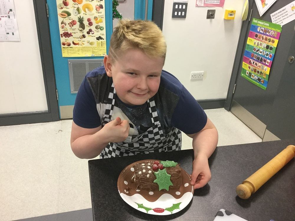 Pupil with their finished Christmas chocolate log