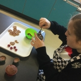 A pupil cooking Christmas buns