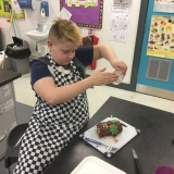 A pupil making a chocolate Christmas log