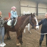 Pupil horse riding