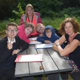 Group picture of staff and pupils at the forest school