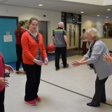 Picture of staff member and pupil training with the GAA
