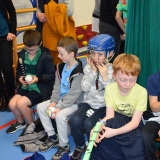 Picture of pupils looking at a hurling stick and helmet