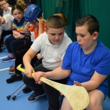 Picture of pupils looking at a hurling stick