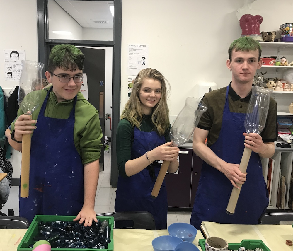 Picture of three pupils working in the Art room during Hallow Green day