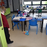 Picture of the Dash robot with its xylophone attached. Programed by students to enter a classroom and play