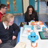 Picture of students learning about programing the Dash robot