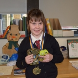 Jessica with her trophies  and medals