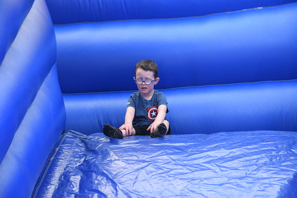 Picture of pupil on large inflatable slide