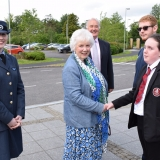 Picture of the Lord Lieutenant of Antrim shaking hands with a pupil