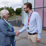 Picture of the Lord Lieutenant of Antrim shaking hands with a member of the teaching staff