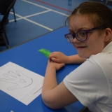 Photograph of a pupil discussing and writing down what made her  feel stressed or 'down'