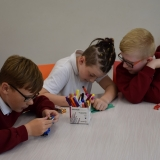 Photographs of pupils discussing and writing down what made them  feel stressed or 'down'