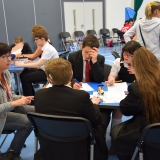 Photograph of staff and pupils discussing and writing down what made them feel stressed or 'down'