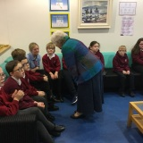 Photograph of Mrs Joan Christie speaking to pupils