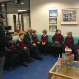 Photograph of Alderman John Smith speaking to pupils