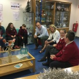 Photograph of the Mrs Joan Christie speaking to the principal, pupils and staff