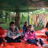 Picture of pupils sitting in the outside den they constructed
