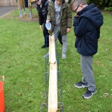 Picture of pupils playing with a self made wooden  water slide