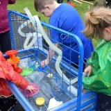 Picture of pupils playing with toys in a water basin