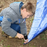 Picture of a pupil constructing a den