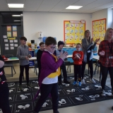 Picture of staff and pupils dancing to chocolate songs