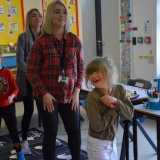 Picture of staff and a pupil dancing to chocolate songs