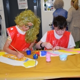 Picture of two pupils painting candy sticks