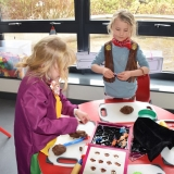 Picture of two pupils making toy sweets with chocolate play dough