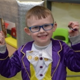 Picture of a pupil dressed as Willy Wonka holding a chocolate play dough sweet