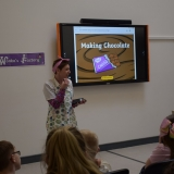 Picture of a teacher giving a presentation on Making Chocolate to the pupils