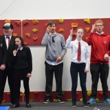 Picture of the school leavers singing and signing a song at the assembly