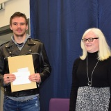 Photograph of Ms Rosaleen Dempsye and a school leaver  with their examination certificate