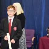 Photograph of a pupil with their character award certificate
