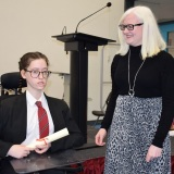 Photograph of Ms Rosaleen Dempsye and a pupil with their character award certificate