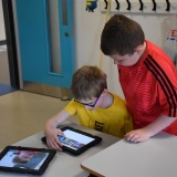 Photograph of pupils working on a iPad