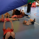Photograph of pupils playing parachute games