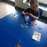 Pupils making football coasters and boot magnets