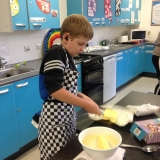 Pupils making brownies