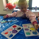 Pupils painting musical instruments