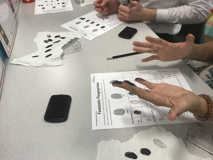 Photograph of pupils taking fingerprints