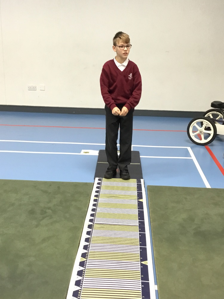 Photograph of a pupil about to long jump