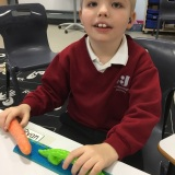 Photograph of a pupil measuring a carrot