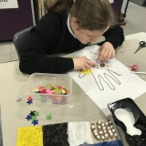 Photograph of a pupil taking part in a tactile art workshop