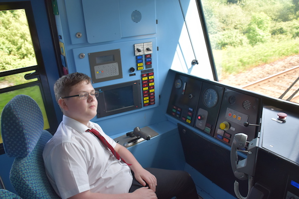 Picture of a pupil in the drivers cab of the train