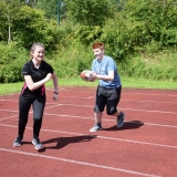 Photograph of two pupils during a tag rugby game